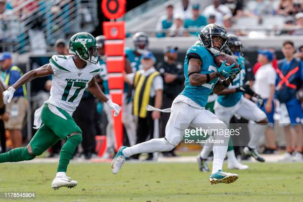 Cornerback AJ Bouye of the Jacksonville Jaguars makes an interception against wide receiver Vyncint Smith of the New York Jets during the game at...
