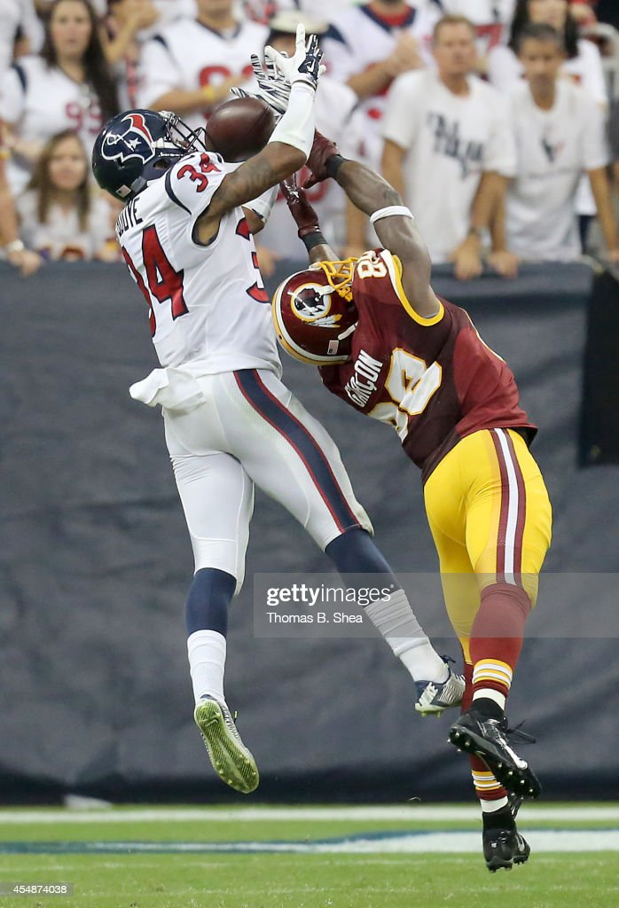 Cornerback A.J. Bouye #34 of theHouston Texans breaks up the pass intended for wide receiver Pierre Garcon #88 of the Washington Redskins in the third quarter on September 7, 2014 at NRG Stadium in Houston, Texas.
