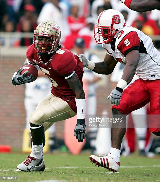 Cornerback AJ Davis of the North Carolina State Wolfpack grabs the jersey of wide receiver Chris Davis of the Florida State Seminoles at Doak...