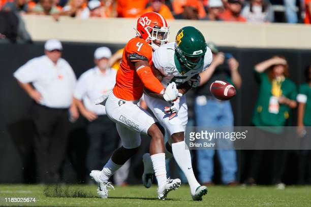 Cornerback AJ Green of the Oklahoma State Cowboys breaks up a pass intended for wide receiver Denzel Mims of the Baylor University Bears in the...