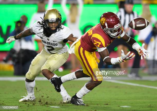 Cornerback Ajene Harris of the USC Trojans intercepts a ball intended for Laviska Shenault Jr #2 of the Colorado Buffaloes and then runs it back for...