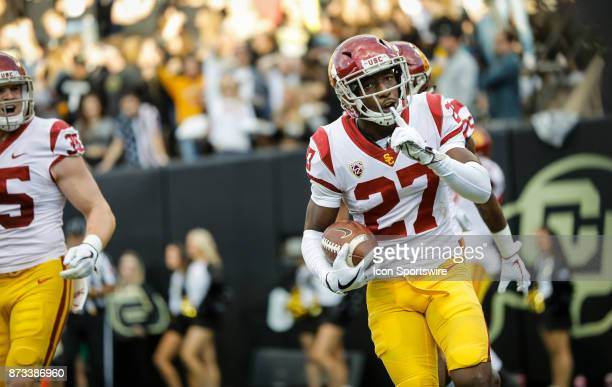 USC cornerback Ajene Harris quiets the crowd after an interception returned for a touchdown against Colorado during the Colorado Buffalos game versus...