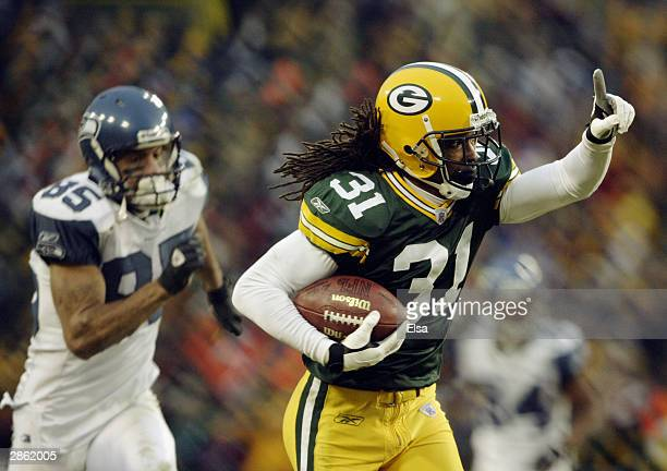 Cornerback Al Harris of the Green Bay Packers returns an interception 52-yards for a touchdown in overtime to give the Packers a 33-27 victory in the...