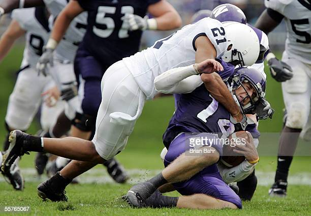Cornerback Alan Zemaitis of the Penn State Nittany Lions tackles quarterback Brett Basanez of the Northwestern Wildcats on a draw play in the fourth...