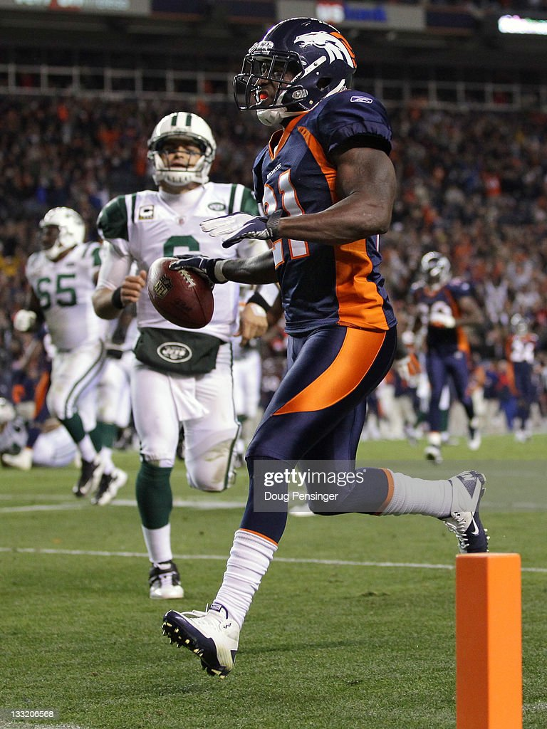 Cornerback Andre' Goodman #21 of the Denver Broncos returns an interception of a pass by quarterback Mark Sanchez #6 of the New York Jets 26 yards for a third quarter touchdown at Sports Authority Field at Mile High on November 17, 2011 in Denver, Colorado.