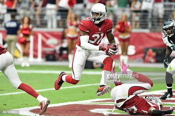 Cornerback Antonio Cromartie of the Arizona Cardinals runs the football after making an interception against the Philadelphia Eagles in the first...