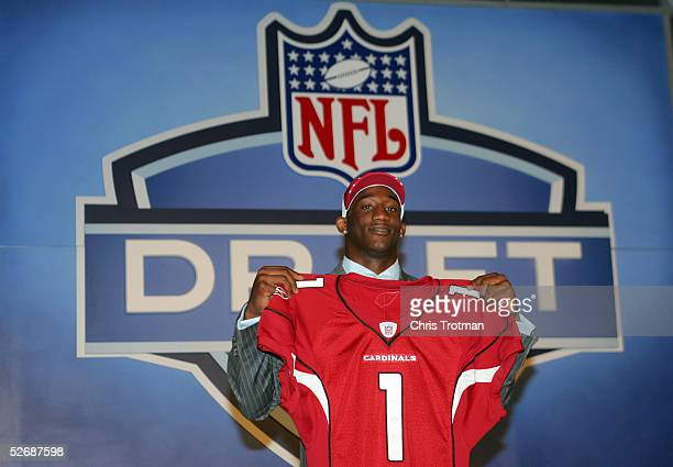 Cornerback Antrel Rolle poses with his jersey after being drafted eighth overall by the Arizona Cardinals during the 70th NFL Draft on April 23, 2005...