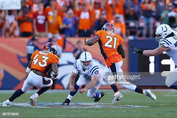 Cornerback Aqib Talib of the Denver Broncos intercepts a ball intended for wide receiver Phillip Dorsett and dodges quarterback Andrew Luck of the...