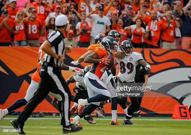 Cornerback Aqib Talib of the Denver Broncos returns an interception of quarterback Joe Flacco of the Baltimore Ravens for a touchdown in the third...
