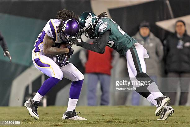 Cornerback Asante Samuel of the Philadelphia Eagles hits helmet to helmet with wide receiver Sidney Rice of the Minnesota Vikings during a game at...