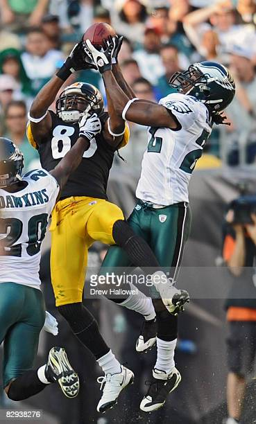 Cornerback Asante Samuel of the Philadelphia Eagles intercepts a pass intended for wide receiver Nate Washington of the Pittsburgh Steelers on...