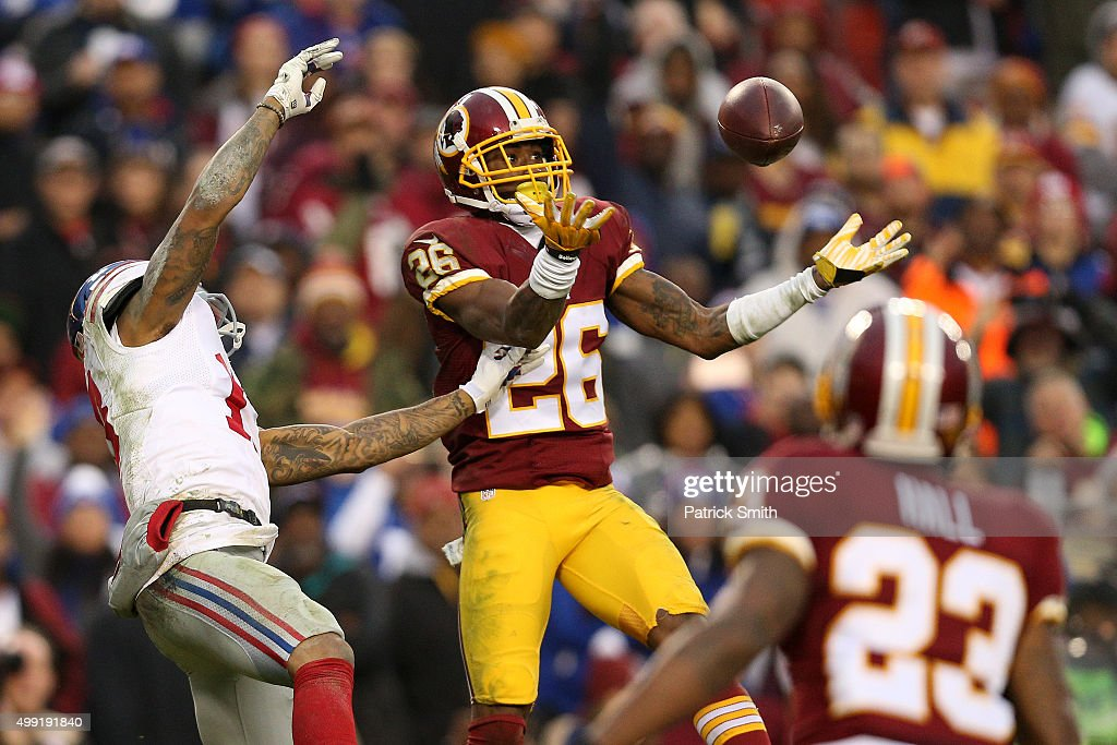 Cornerback Bashaud Breeland #26 of the Washington Redskins breaks up a pass intended for wide receiver Odell Beckham #13 of the New York Giants defends in the fourth quarter at FedExField on November 29, 2015 in Landover, Maryland.