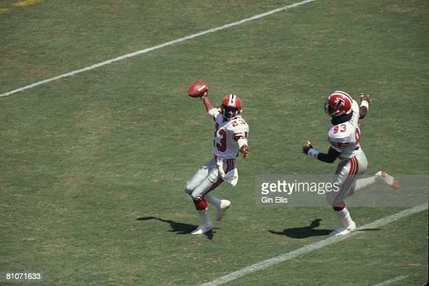 Cornerback Bobby Butler of the Atlanta Falcons scores on a 29yard fumble recovery as teammate linebacker Aundray Bruce celebrates against the Dallas...