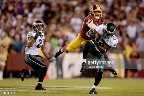 Cornerback Brandon Boykin of the Philadelphia Eagles intercepts a pass in front of wide receiver Santana Moss of the Washington Redskins in the first...