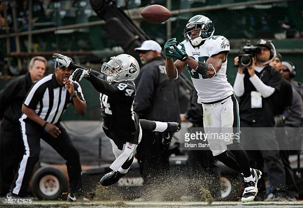 Cornerback Brandon Boykin of the Philadelphia Eagles nearly intercepts a pass intended for wide receiver Juron Criner of the Oakland Raiders in the...