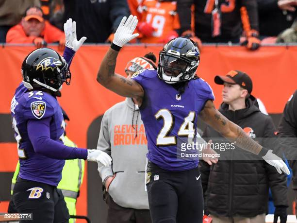 Cornerback Brandon Carr and safety Eric Weddle of the Baltimore Ravens celebrates an incomplete pass in the first quarter of a game on December 17...