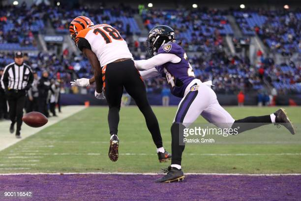 Cornerback Brandon Carr of the Baltimore Ravens breaks up a pass to wide receiver AJ Green of the Cincinnati Bengals in the first quarter at MT Bank...