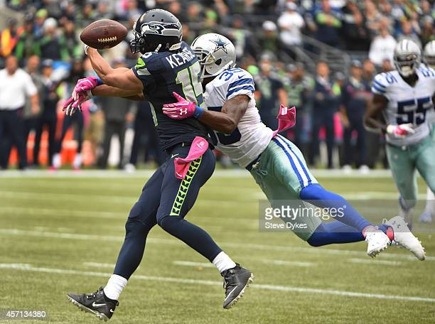 Cornerback Brandon Carr of the Dallas Cowboys breaks up a pass intended for wide receiver Jermaine Kearse of the Seattle Seahawks during the fourth...