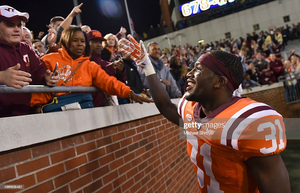 Cornerback Brandon Facyson #31 of the Virginia Tech Hokies celebrates with fans following the game against the Georgia Tech Yellow Jackets at Bobby Dodd Stadium on November 12, 2015 in Atlanta, Georgia. Virginia Tech defeated Georgia Tech 23-21.