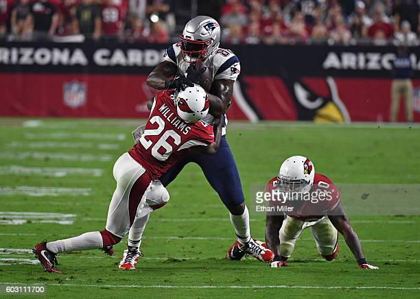 Cornerback Brandon Williams of the Arizona Cardinals tackles tight end Martellus Bennett of the New England Patriots after a reception as outside...