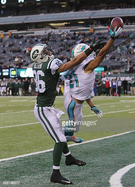 Cornerback Brent Grimes of the Miami Dolphins breaks up an End Zone pass intended for Wide Receiver David Nelson of the New York Jets at MetLife...