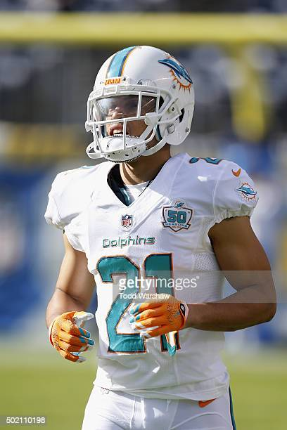 Cornerback Brent Grimes of the Miami Dolphins warms up before a game against the San Diego Chargers at Qualcomm Stadium on December 20 2015 in San...