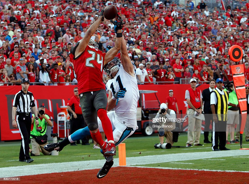 Cornerback Brent Grimes #24 of the Tampa Bay Buccaneers breaks up a pass from quarterback Cam Newton #1 of the Carolina Panthers to wide receiver Brenton Bersin #11 in the end zone during the fourth quarter of an NFL game on January 1, 2017 at Raymond James Stadium in Tampa, Florida.