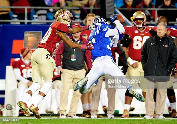 Cornerback Breon Borders of the Duke Blue Devils intercepts a ball intended for wide receiver Rashad Greene of the Florida State Seminoles during the...