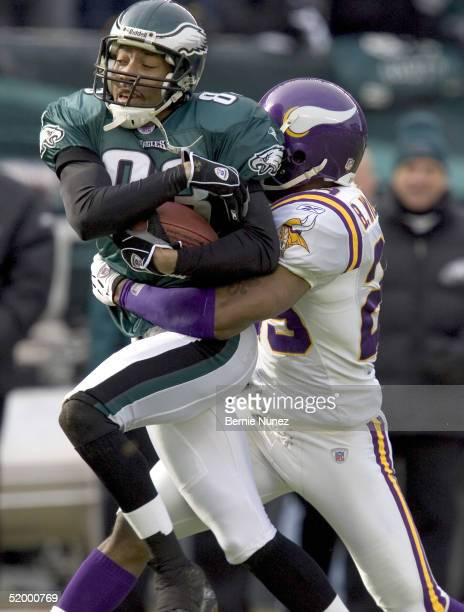 Cornerback Brian Williams of the Minnesota Vikings brings down wide receiver Greg Lewis of the Philadelphia Eagles after a 52-yard pass reception in...