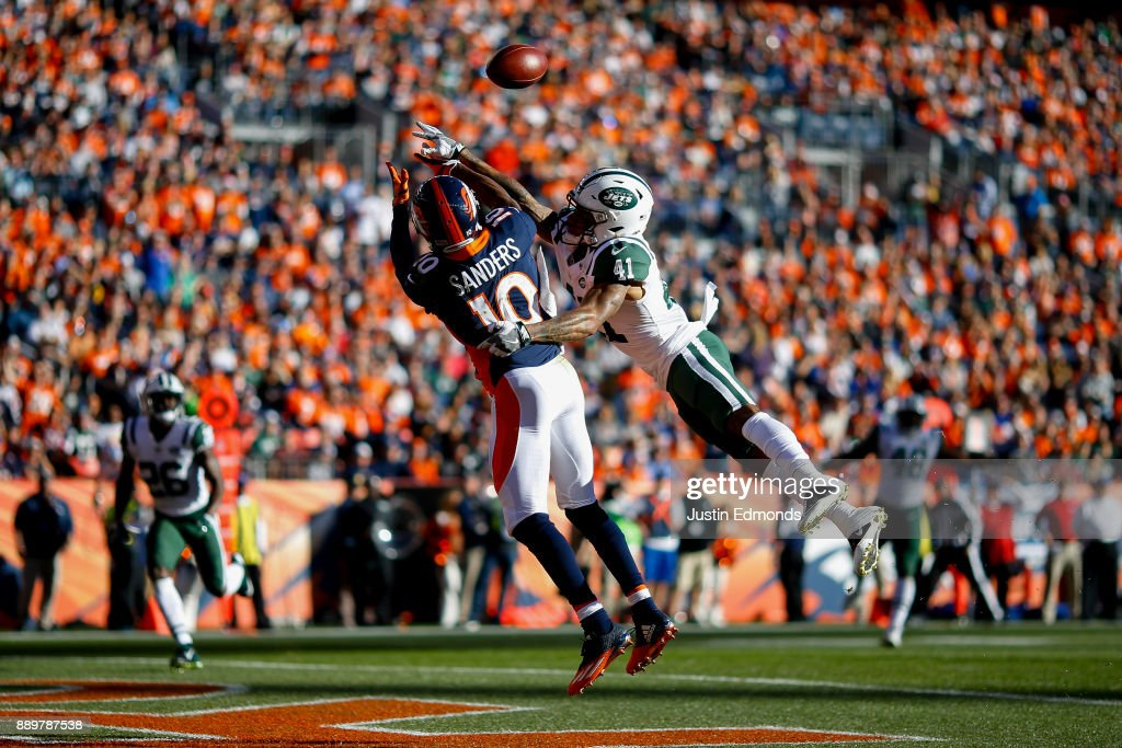 Cornerback Buster Skrine #41 of the New York Jets defends a pass away from wide receiver Emmanuel Sanders #10 of the Denver Broncos during the first quarter at Sports Authority Field at Mile High on December 10, 2017 in Denver, Colorado.