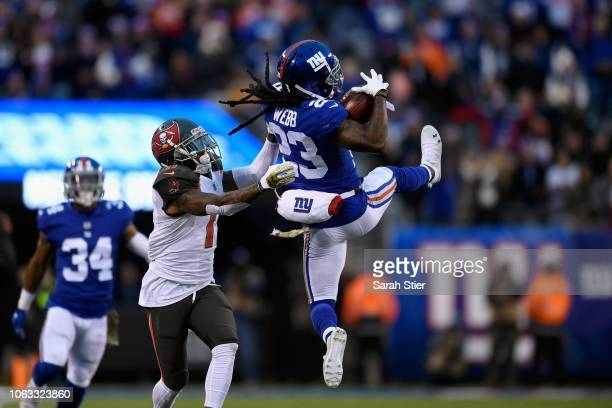 Cornerback BW Webb of the New York Giants makes a reception against wide receiver DeSean Jackson of the Tampa Bay Buccaneers during the fourth...
