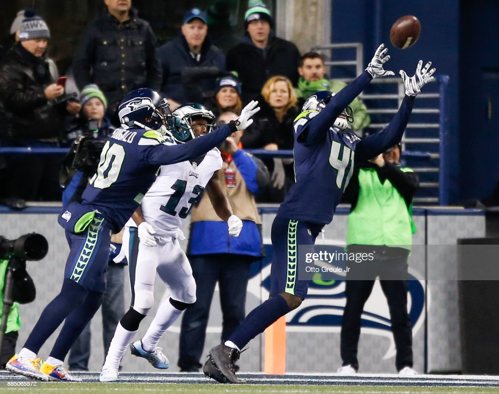 Cornerback Byron Maxwell #41 of the Seattle Seahawks makes an interception on a pass intended for wide receiver Nelson Agholor #13 of the Philadelphia Eagles in the fourth quarter at CenturyLink Field on December 3, 2017 in Seattle, Washington.