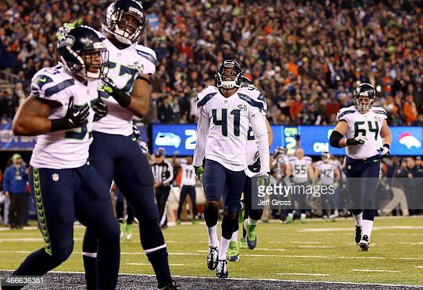 Cornerback Byron Maxwell of the Seattle Seahawks smiles after utside linebacker Malcolm Smith of the Seattle Seahawks ran 69-yards to score a...