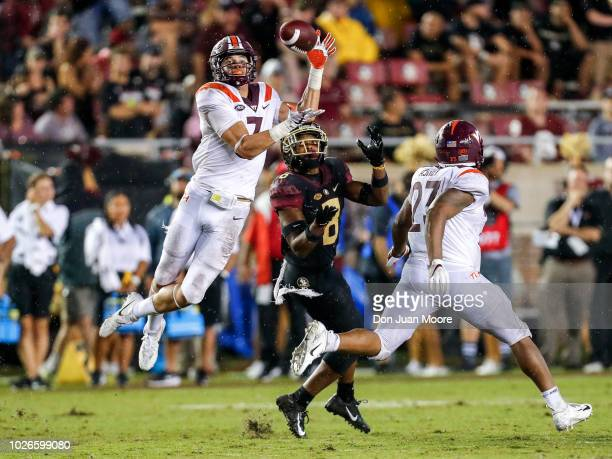 Cornerback Caleb Farley of the Virginia Tech Hokies intercepts the ball over Wide Receiver Nyqwan Murray of the Florida State Seminoles during the...