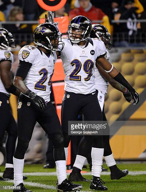 Cornerback Cary Williams of the Baltimore Ravens congratulates cornerback Corey Graham after Graham defended on a pass play during a game against the...