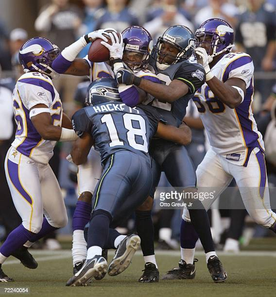 Cornerback Cedric Griffin of the Minnesota Vikings is tackled by DJ Hackett and Darrell Jackson of the Seattle Seahawks after intercepting a pass in...
