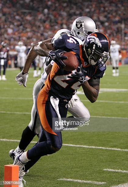 Cornerback Champ Bailey intercepts a pass intended for Oakland Raiders wide receiver Randy Moss. The Denver Broncos defeated the Oakland Raiders by a...