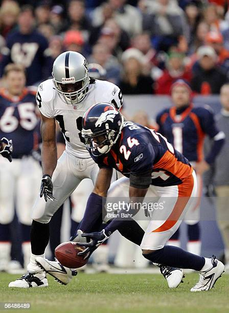 Cornerback Champ Bailey nearly intercepts a pass thrown to the feet of Randy Moss of the Oakland Raiders in the third quarter on December 24, 2005 at...