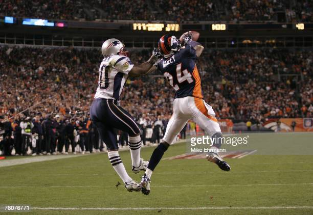 Cornerback Champ Bailey of the Denver Broncos intercepts a pass in the endzone from receiver Troy Brown during the AFC Divisional Playoff game...