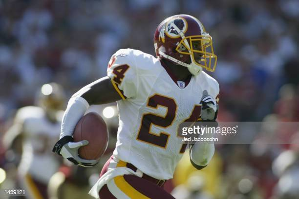 Cornerback Champ Bailey of the Washington Redskins runs the ball against the San Francisco 49ers during the NFL game on September 22 2002 at...
