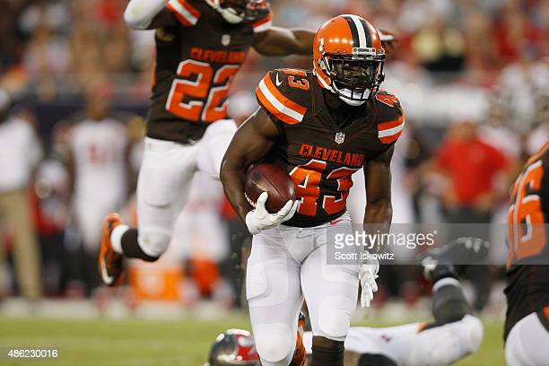 Cornerback Charles Gaines of the Cleveland Browns runs with the ball after an interception during the preseason game between the Tampa Bay Buccaneers...