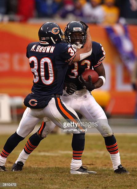 Cornerback Charles Tillman and safety Mike Brown of the Chicago Bears celebrate Tillman's interception in the end zone late in a game against the...