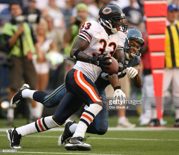 Cornerback Charles Tillman of the Chicago Bears intercepts a pass against wide receiver Jordan Kent of the Seattle Seahawks at Qwest Field on August...