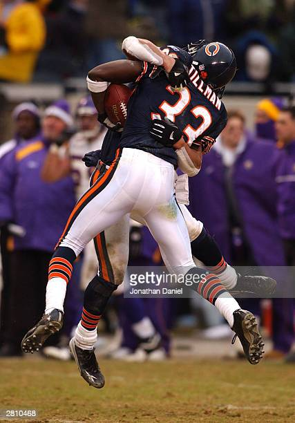 Cornerback Charles Tillman of the Chicago Bears is hugged by teammate safety Mike Brown after intercepting a pass in the end zone late in a game...