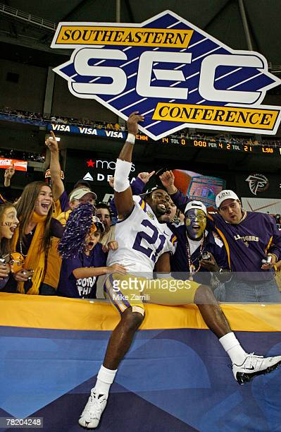 Cornerback Chevis Jackson of the LSU Tigers celebrates in the stands with LSU fans under the SEC sign after the SEC Championship game against the...