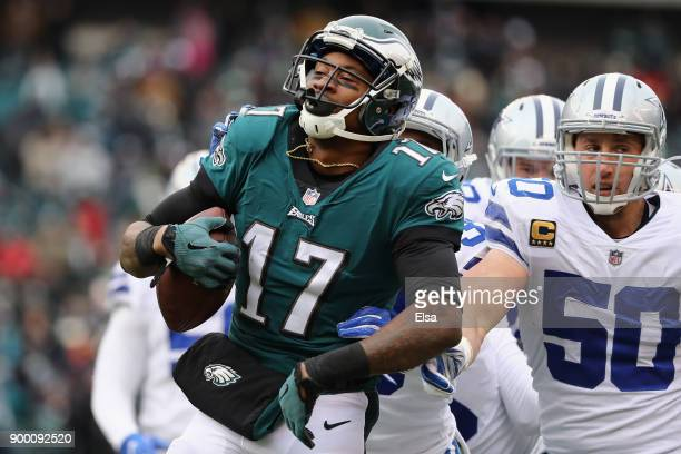 cornerback Chidobe Awuzie and middle linebacker Sean Lee of the Dallas Cowboys tackle wide receiver Alshon Jeffery of the Philadelphia Eagles during...