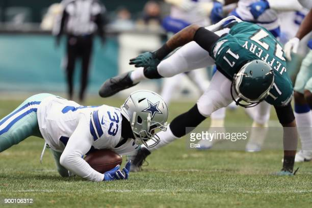 Cornerback Chidobe Awuzie of the Dallas Cowboys picks off a pass intended for wide receiver Alshon Jeffery of the Philadelphia Eagles during the...
