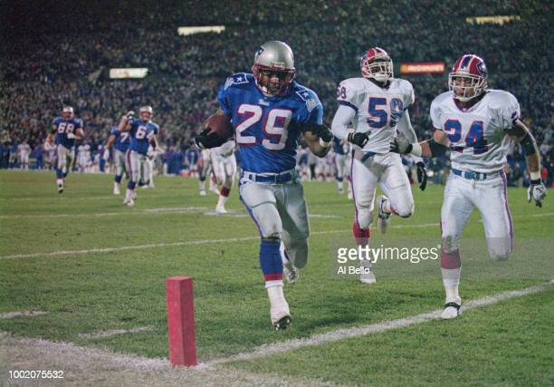 Cornerback Chris Canty of the New England Patriots in action against linebacker Mario Perry and safety Kurt Schult of the Buffalo Bills during their...