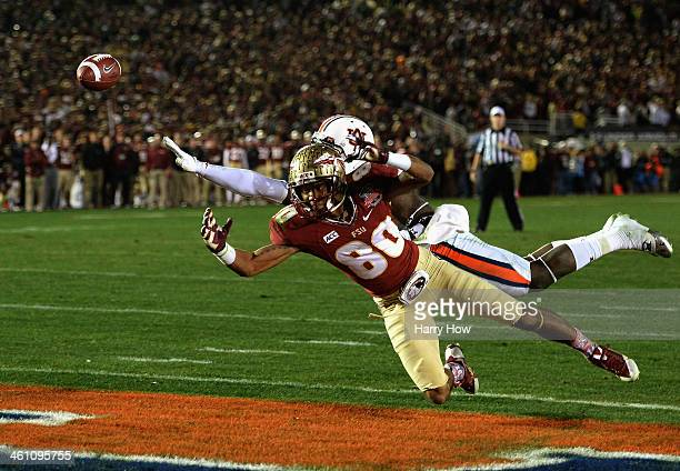 Cornerback Chris Davis of the Auburn Tigers Wide interferes with receiver Rashad Greene of the Florida State Seminoles and is called for a penalty in...