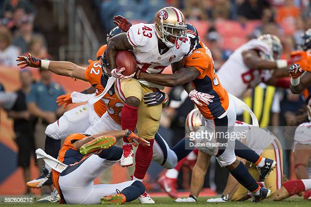 Cornerback Chris Davis of the San Francisco 49ers is stopped on a first quarter kickoff return against the Denver Broncos during a preseason NFL game...